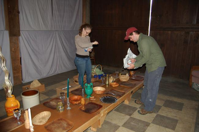 LINDA KOEHLER/TIMES NEWS Antonia and Jeremiah Dowling prepare the scenery of The Last Supper for The Barn's Scarlet Steps mixed media art show that tells the story of Easter through the eyes of local artists.