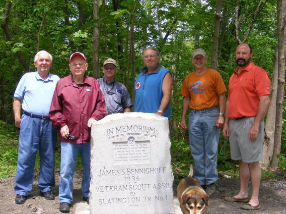 "Sharon Stanley/special to the Times News Former Troop 65 members, from left, Bill Carlton, Sherwood ""Popeye"" Yenser, Dale Pugh, Donald Eckhart, Vince Morris and David Harding gather around the newly placed Boy Scout monument along the Slate Heritage…"