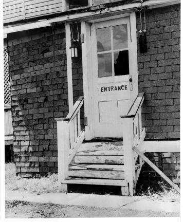 (ACME) COURTESY TAMAQUA HISTORICAL SOCIETY Bullet holes and broken glass in the Amber Lantern's side door attest to the violence on Flag Day 1938.