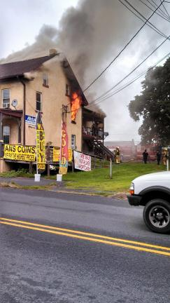 SUSAN BRYANT/SPECIAL TO THE TIMES NEWS Volunteer firefighters from 14 fire companies fought a three-alarm fire just after noon Tuesday at 4701 Route 309 in Schnecksville. Six more companies were on standby in the area.