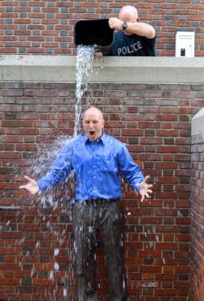 "Jarrad Hedes/Times News District Judge William Kissner takes the ""Ice Bucket Challenge"" for ALS  awareness on Tuesday with the help of Palmerton Borough Police Chief Randy Smith."
