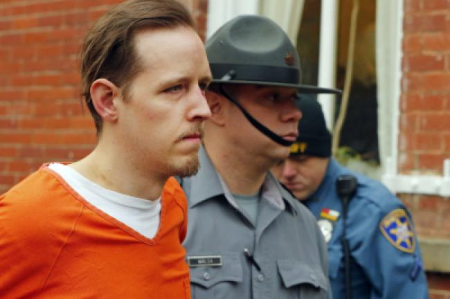 FILE - In this Oct. 31, 2014, file photo, Eric Frein is escorted by police out of the Pike County Courthouse after his arraignment in Milford, Pa. Frein, a survivalist who shot and killed a Pennsylvania State Police trooper and injured another in an…