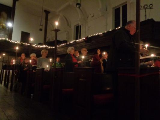People are celebrating Christmas together at Christmas Eve Church Services